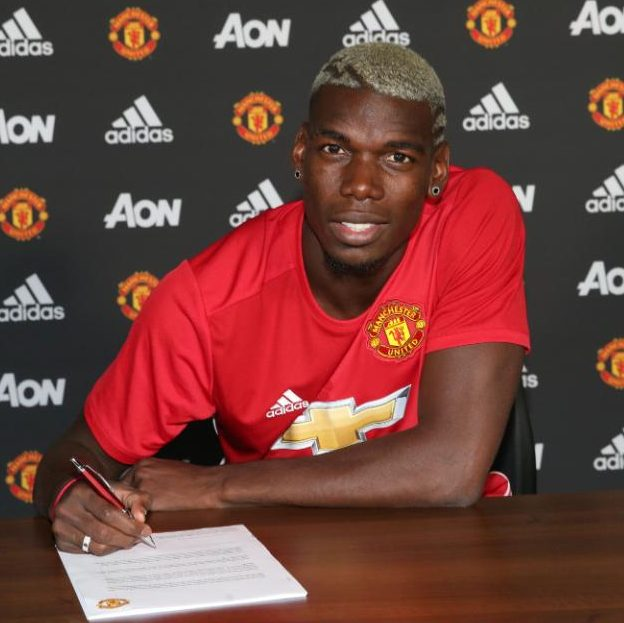 pogba signs